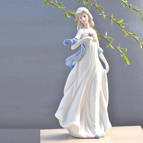 Ceramic Holding Flowers Girl Statue Porcelain Figurine
