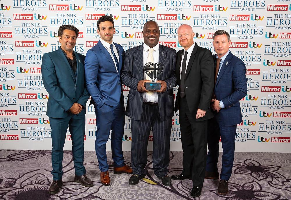 Errol McKellar Winner of 'Hero Volunteer' at The Mirror & ITV's The NHS Heroes Awards with the cast of EastEnders