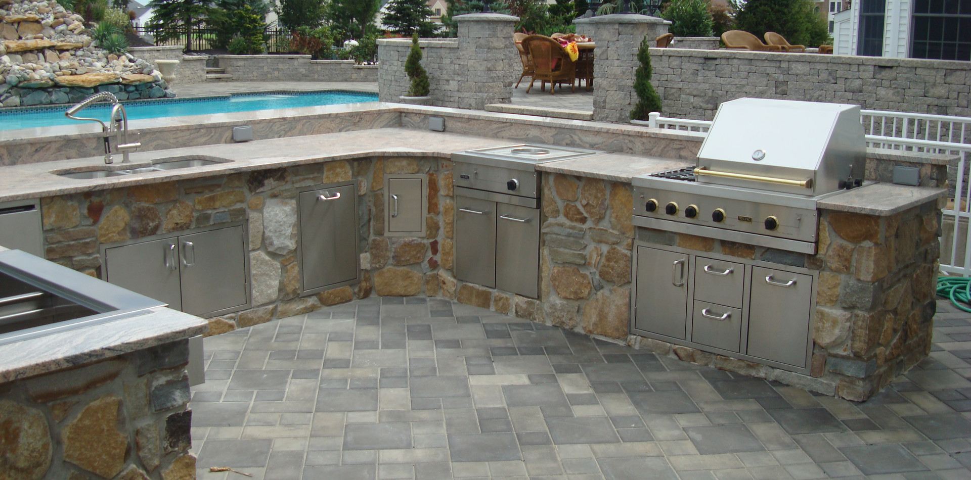 classic outdoor kitchen large with pool
