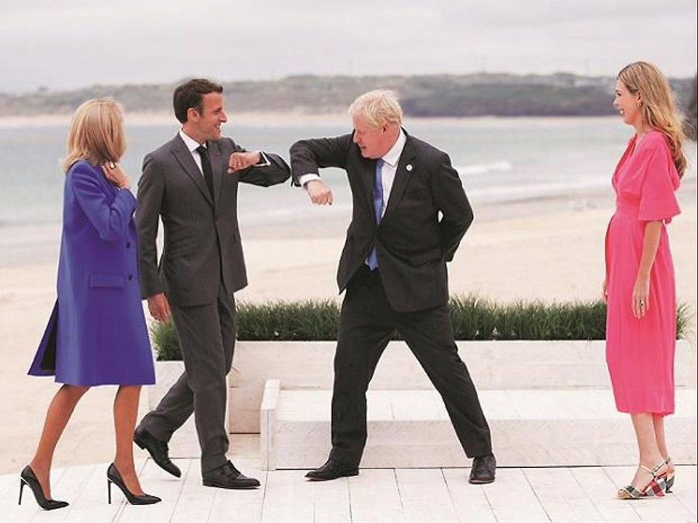 British PM Boris Johnson greets French President Emmanuel Macron