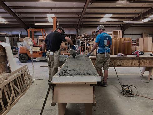 Levi and Geron pouring concrete