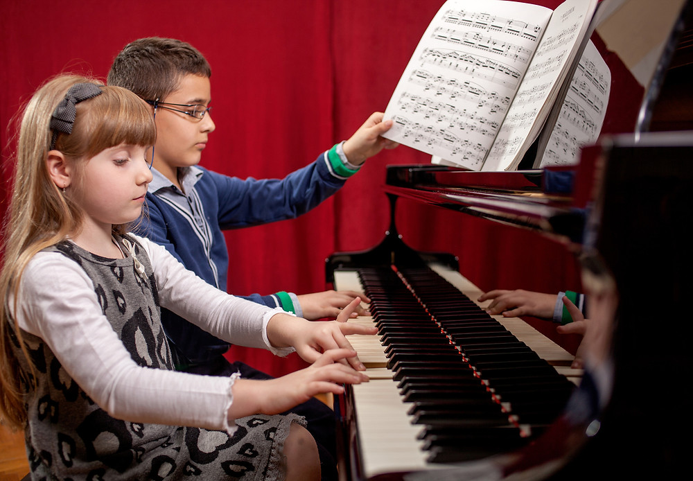 Boy and Girl Practicing Piano