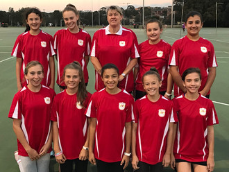 Looking great in their new Netball training shirts.
