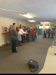 In the new location with Chamber of Commerce ribbon cutting