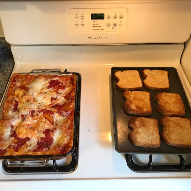 Lasagna, fresh salad greens from our garden and garlic toast!