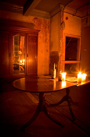 Ghost of a young girt lit by candlelight