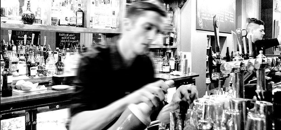 Barman making cocktails