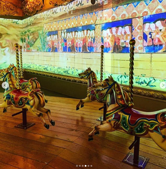 Visitors may ride on Carousel horse whilst watching the content