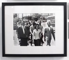 On April 19, 1960, the day of the Z. Alexander Looby bombing, as many as four thousand demonstrators marched down Jefferson Street toward city hall. In the first row are Rev. C. T. Vivian (left), Diane Nash of Fisk, and Bernard Lafayette of American Baptist Seminary. In the second row are Kenneth Frazier and Curtis Murphy of Tennessee A&I, and Rodney Powell of Meharry. Using his handkerchief in the third row is Rev. James Lawson.