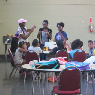 Opportunity Now leading kids from summer camp on art projects.