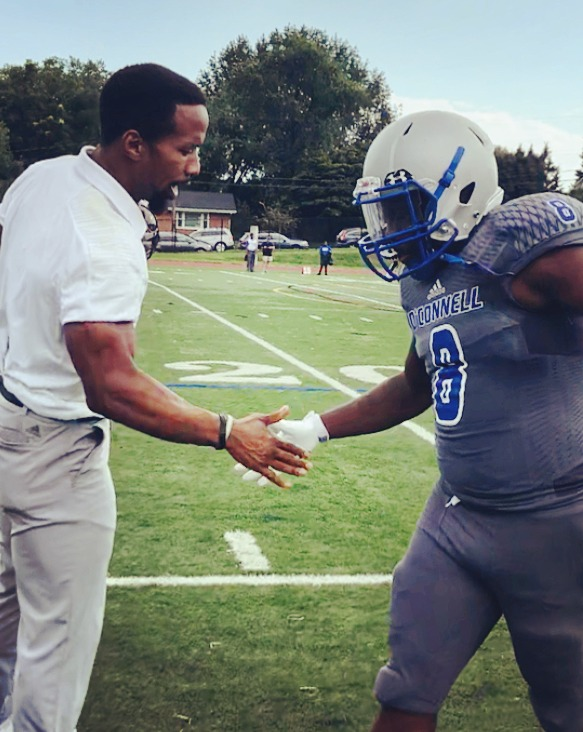 Pre-game hand shake with star Running Back Kai Bowers