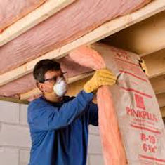 This image shows fiberglass batt insulation being installed in Atlanta GA