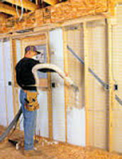 This image shows blown in blanket insulation being installed in Atlanta GA