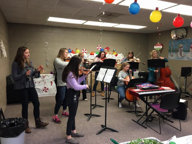 Student musicians performing at the holiday buffet