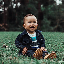 photo-of-smiling-baby-boy-in-denim-outfi