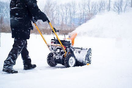 a-man-cleans-snow-B8AQH9T.jpg