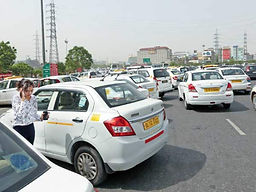 Cabs flocking outside a corporate complex;picture:timesofindia.indiatimes.com.jfif