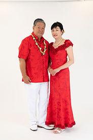 Red holomuu and Hawaiian shirt