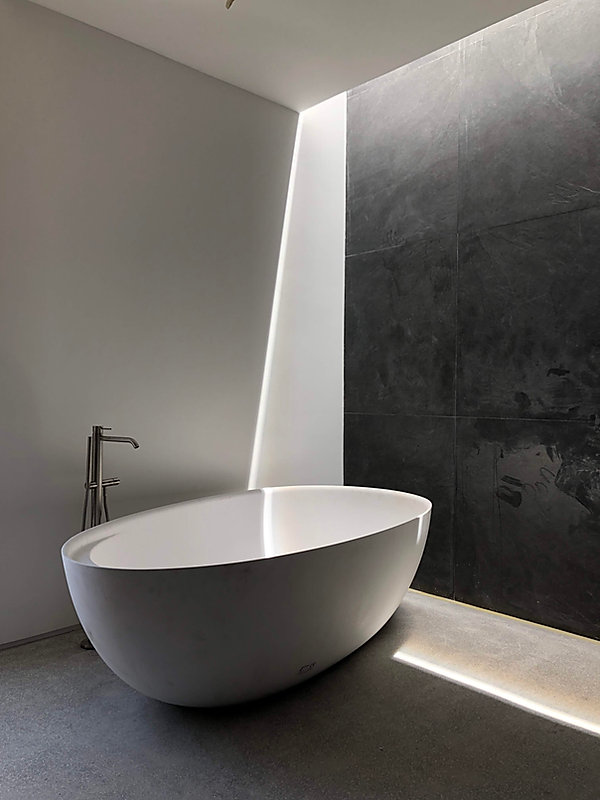 modern bathroom at Las Catalinas in Costa Rica designed by Inverse Project | simple modern bathroom design | slot skylight in the bathroom