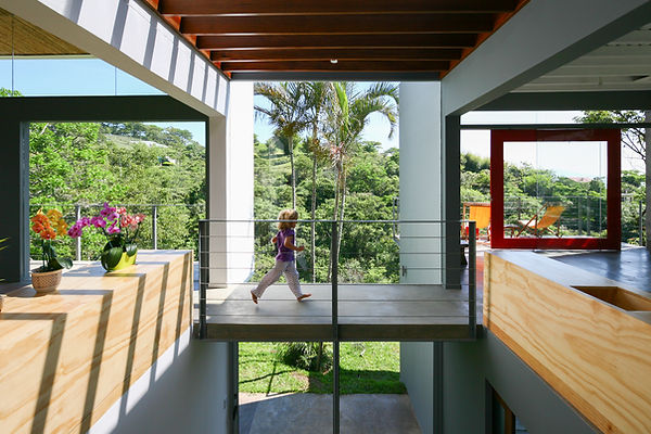 Modern sustainable home with a interior bridge  in Costa Rica designed by Inverse Project