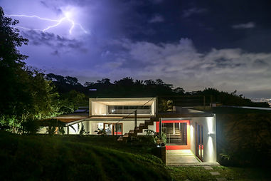 Lightening over Modern sustainable home in Costa Rica designed by Inverse Project