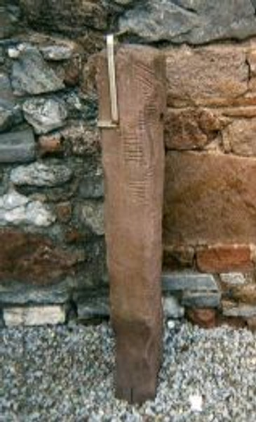 Ogham stone found built into a church wall in Tralee, Co Kerry. (from Wikimedia Commons)