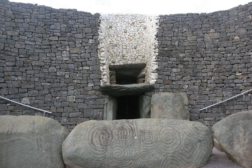 The entrance to Newgrange burial mound, showing the highly decorated entrance stone.