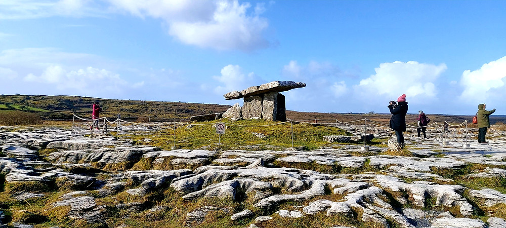 A wide angle image of Poulnabrone dolmen being photographed by tourists