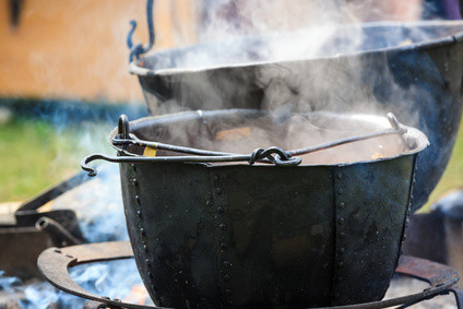 2 iron cauldrons on campfires with steaming rising from contents