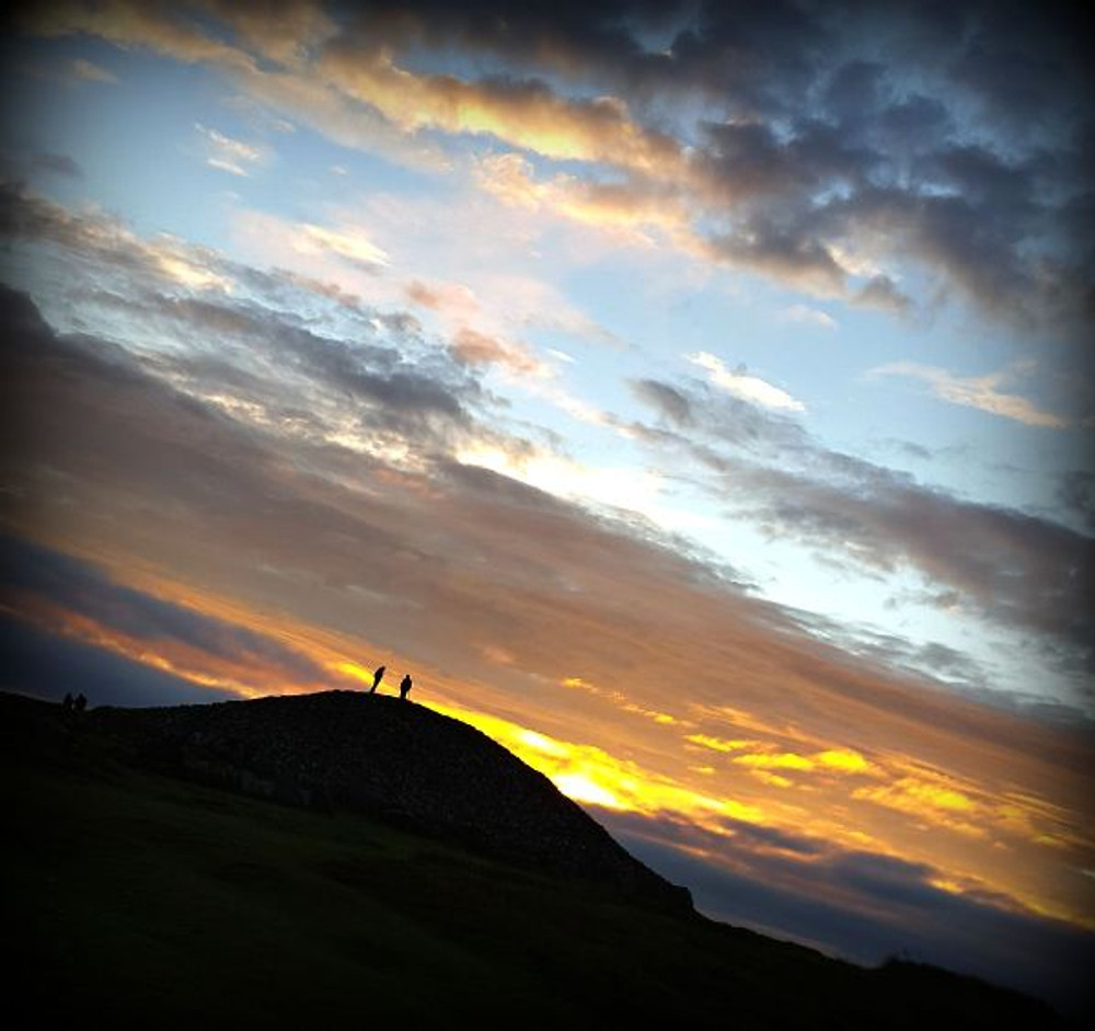 Autumn Equinox sun dawning over cairn T at Loughcrew