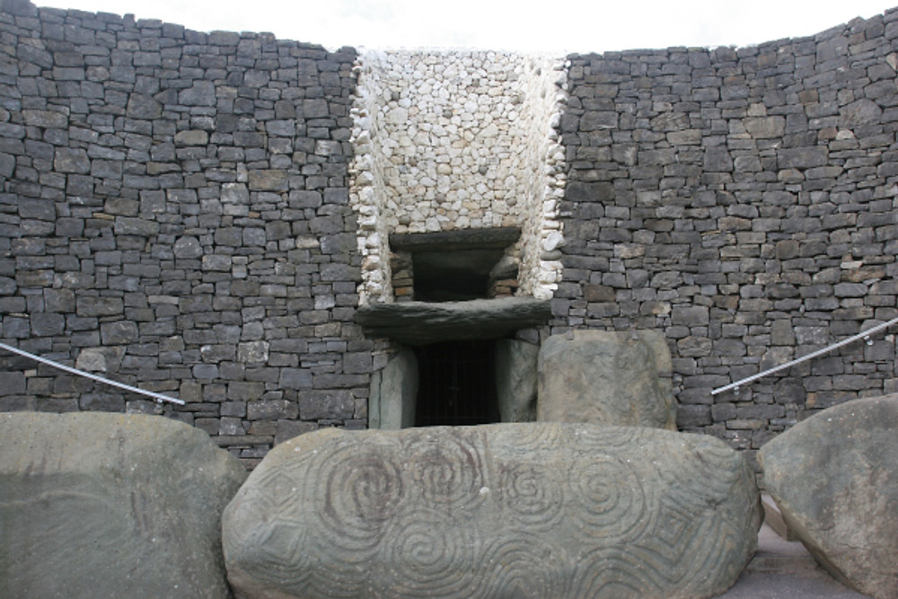 Entrance to Newgrange, showing the knot work scrolls featured on the great entrance stone
