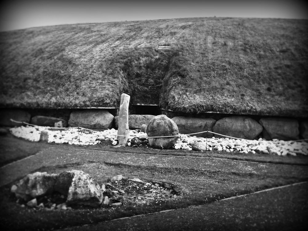 Entrance to main central mound at Knowth, showing the two sentinel stones, one phallus shaped, the other, well... not.