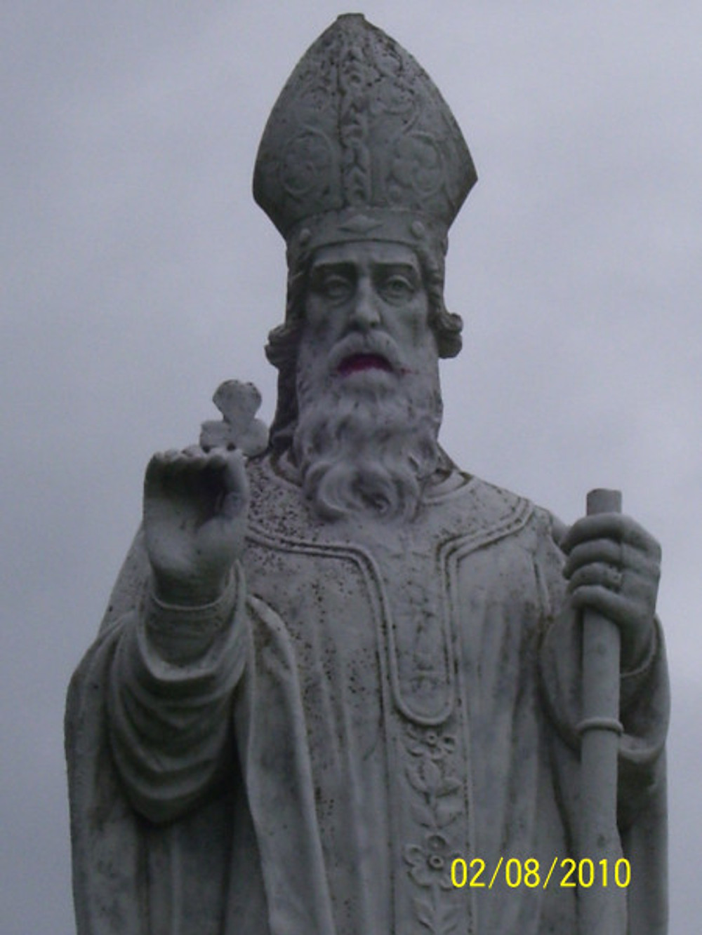 St Patrick statue, white marble, holding 3 leaf clover