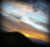 Silhouette of Loughcrew burial mound, Ireland, at equinox sunrise.