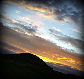 Silhouette of Loughcrew burial mound, Ireland, at equinox sunrise.