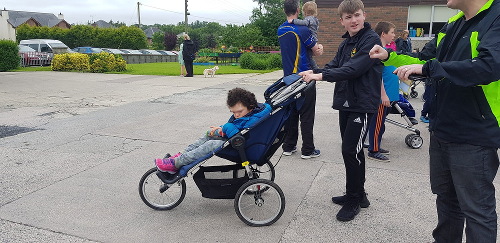 Carys's Sponsored Walk. #livingwithaspecialneedschild 'cardiofaciocutaneoussyndrome #raredesease. Waiting for the off with big brother Malachy in charge of the buggy.