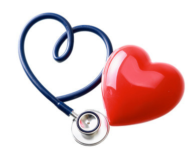 A stethoscope twisted into a heart shape beside a shiny red heart-shaped balloon.