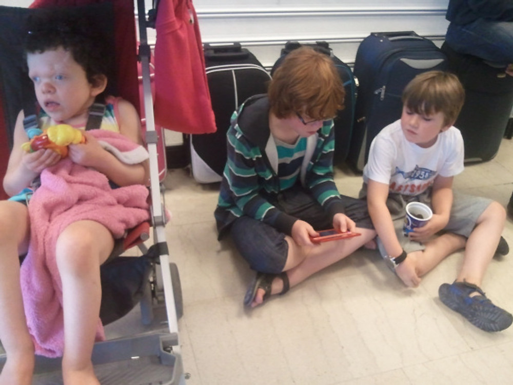 In Kos airport with all our hand luggage rowed up behind us.