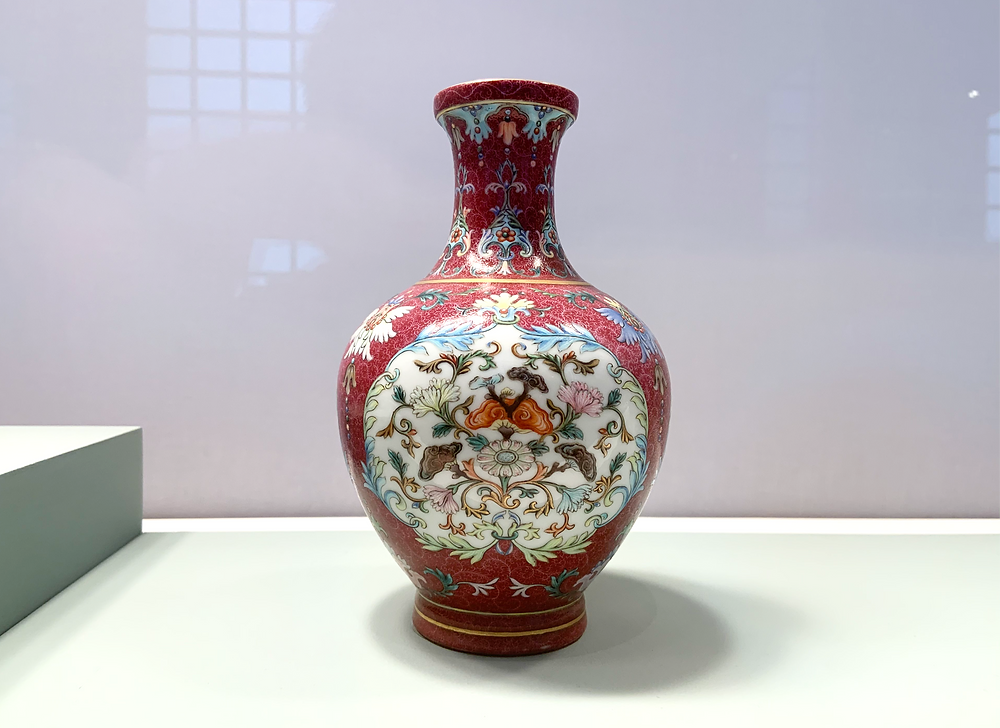 Famille Rose Red Ground 'Floral and Lingzhi Fungus' Bottle Vase