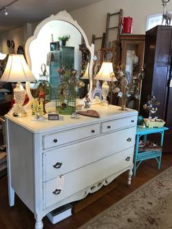 Antique dresser with mirror.