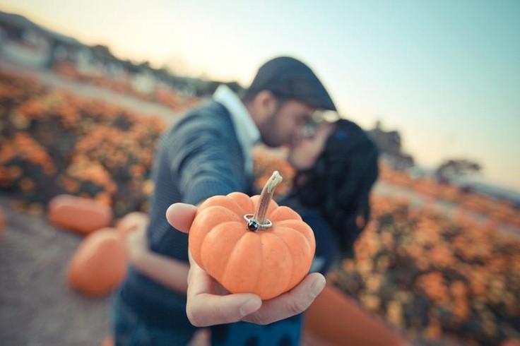 couple, kiss, ring, pumpkin, pumpkin patch, pumpkin picking, dark ring, outdoor proposal, outdoor kiss
