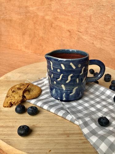 Waxy raindrop blue milk jar