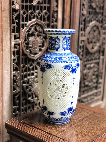 Blue and white hand-carved vase