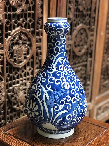 Blue and white narrow neck vase