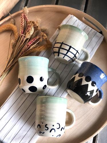 Handmade half glazed tall cup