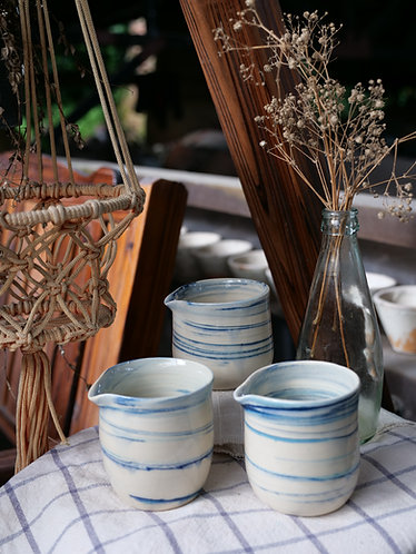 Marbled sky blue milk jar