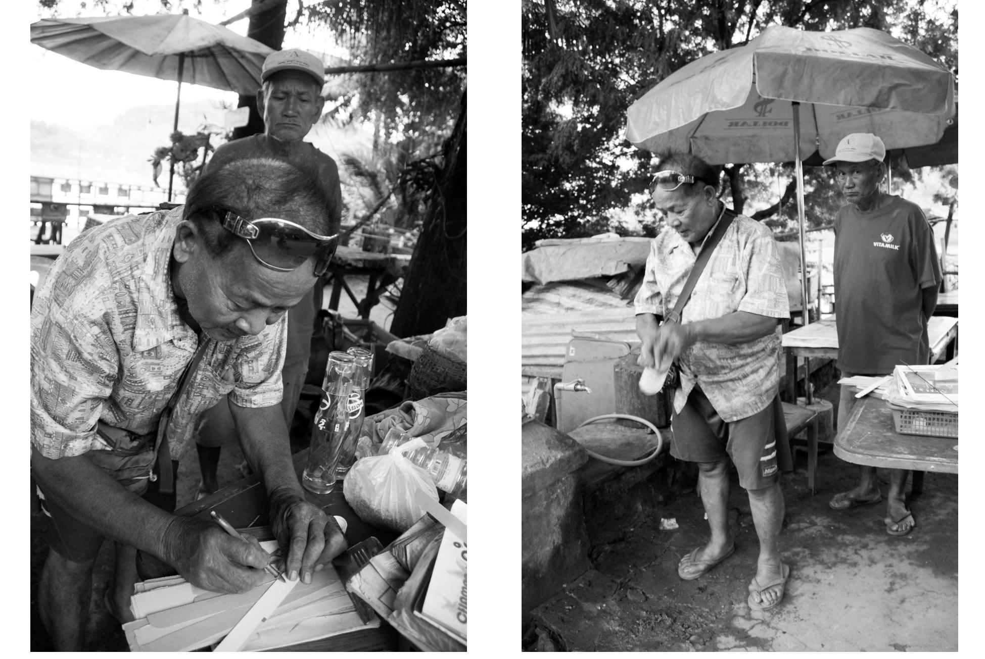 Laos, old men in street market