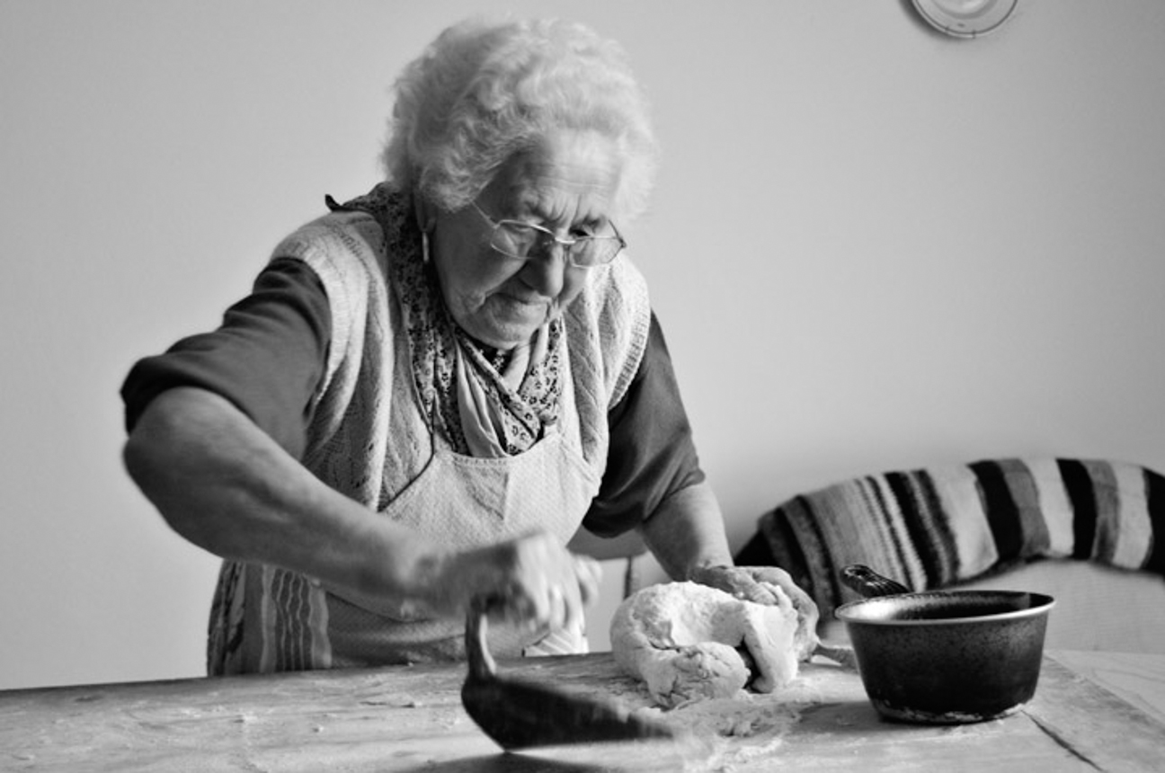 Reportage, old lady cooking