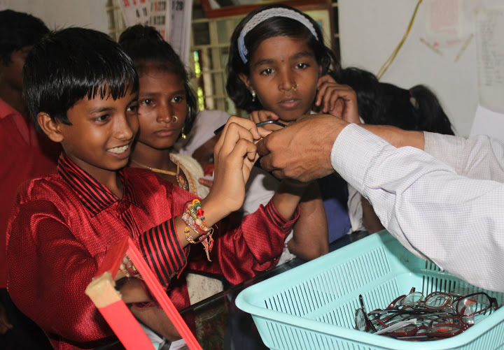 Children are distributed spectacles after checkup