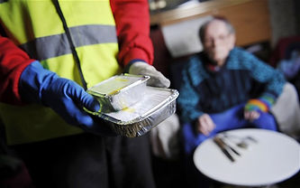 Meals on Wheels service being delivered to elderly